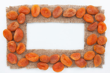 Frame made of burlap with dried apricots