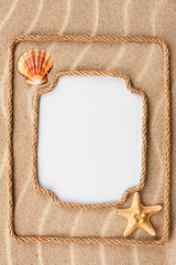 Two beautiful frame made of rope and sea shells with a white bac