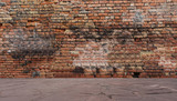 Fototapety Old red brick wall with stone floor