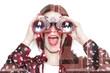 Double exposure of girl looking through binoculars and chocolate