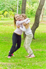 Cute two embracing girls