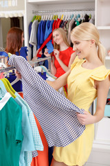 Woman chooses clothes in a store