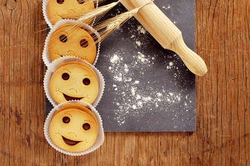 smiley biscuits on a wooden rustic table