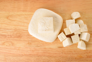 Tofu cubes on wooden