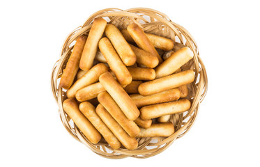 Bread sticks with salt in wicker basket, top view