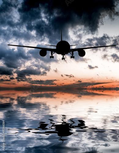 aircraft flies over the ocean - 81366064