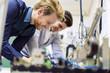 Leinwanddruck Bild - Two young handsome engineers working on electronics components