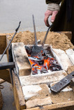 old blacksmith forge with hot coals