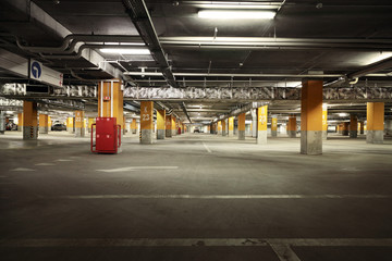 Image of parking garage underground interior, dark industrial bu