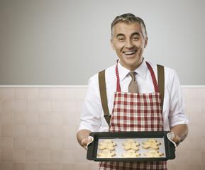 Man cooking gingerbread men