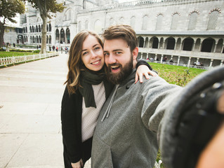 Couple of tourists make selfie photo in Istanbul, Turkey