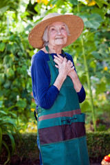Thoughtful Senior Woman in Garden Hat and Apron.