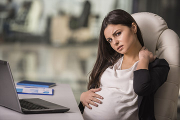 Pregnant businesswoman