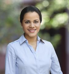 Young executive latin woman smiling