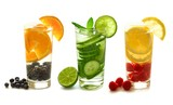 Three types of detox water with fruit in glasses isolated