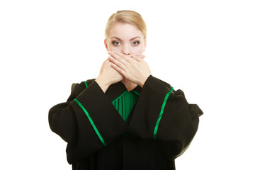 Woman lawyer barrister covering mouth with hands.