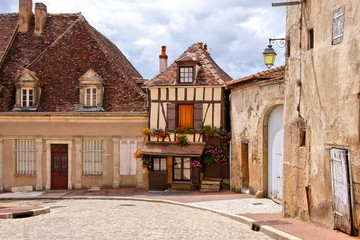 Quaint street in a town in Burgundy, France with timbered house