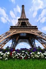 Eiffel Tower upward view with flowers, Paris, France