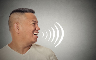 man talking with sound waves coming out of his open mouth