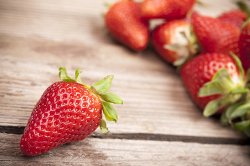 Strawberries closeup on wooden background