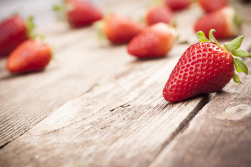 Delicious strawberries on wooden background