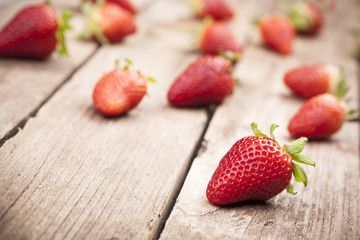 Appetizing strawberries on wooden background