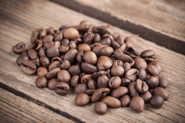 Coffee beans close-up on wooden background