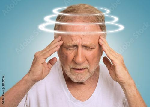 Leinwanddruck Bild Headshot senior man with vertigo suffering from dizziness