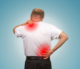 Senior man with lower and upper back pain