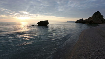 Sound of the surf and Potistika beach sunrise view (Greece).