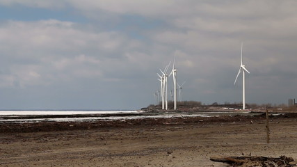 Wind Turbines Over A Frozen Lake.