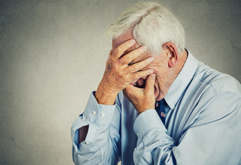 sad depressed senior, old man covering his face with hands