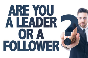 Business man pointing the text: Are You a Leader or a Follower?