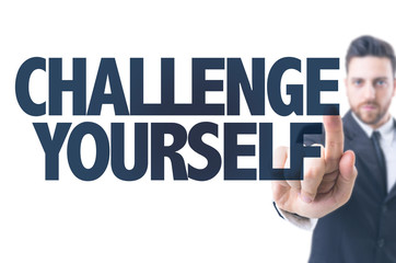 Business man pointing the text: Challenge Yourself