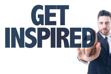Business man pointing the text: Get Inspired