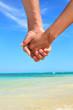 Love - romantic couple holding hands on beach