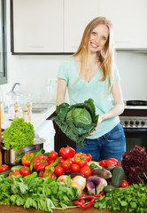 Portrait of  beautiful woman with raw vegetables