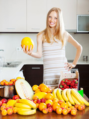 Positive blonde long-haired woman with melon