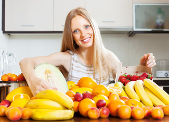 Happy  blonde housewife with ripe fruits