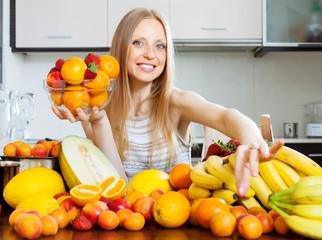 Happy blonde   woman choosing  fruits