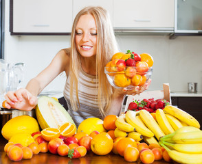 woman taking fruits from table in home