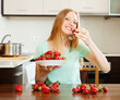 long-haired woman eating strawberries