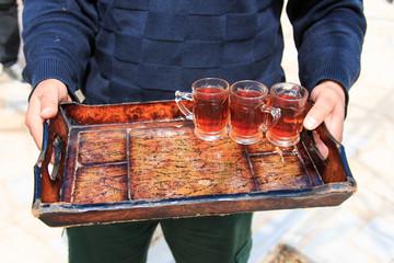 Jordanian man offering tea to the tourists