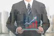 Businessman holding touch pad