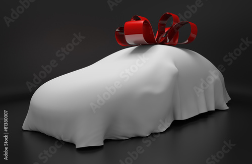 Auto concept of a new covered sports car with a red gift ribbon - 81380007