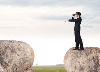Businessman on rock mountain