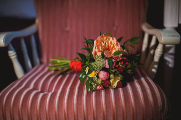 Beautiful bright bridal bouquet lying on vintage chair