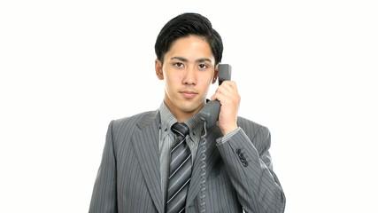 受話器を持つビジネスマン