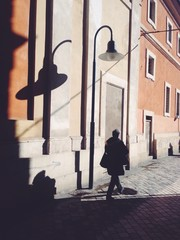 Streetlight and shadows on a ancient wall in Ravenna street.