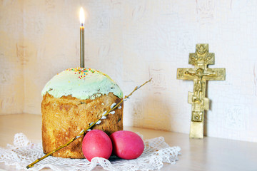 Christian Easter still life with red eggs and burning candle